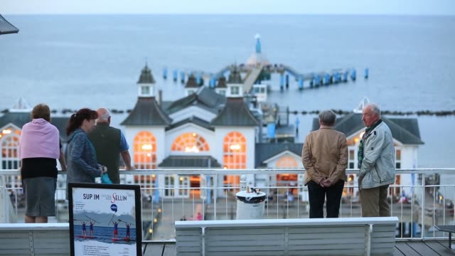 pensioners look at the baltic sea on the beachfront in sellin ruegen island germany on saturday aug 27 2016 - nordeuropäischer abstammung stock-videos und b-roll-filmmaterial