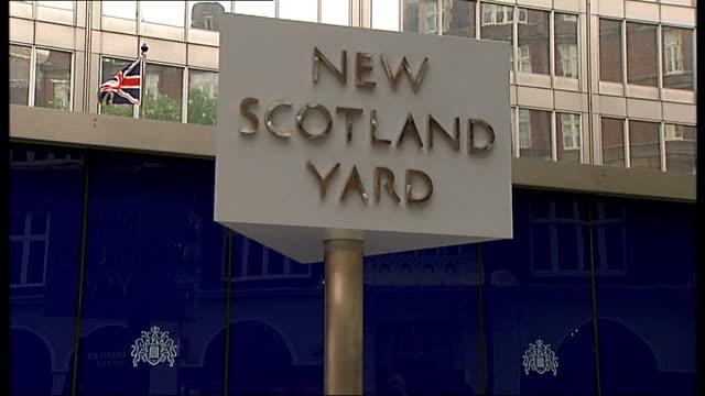 pensions of police officers could be cut to punish misconduct new scotland yard 'new scotland yard' revolving sign - ニュースコットランドヤード点の映像素材/bロール