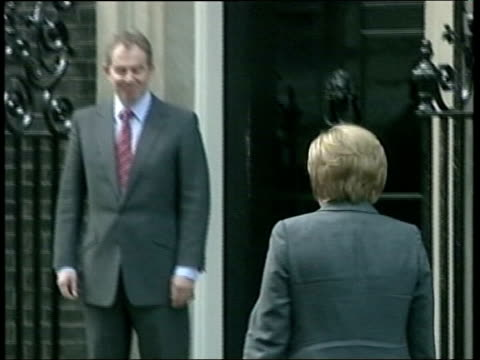 pensions commission brown accused of sabotage downing street german chancellor angela merkel across pan as greeted by bair and posing for photocall - 2005 stock videos & royalty-free footage