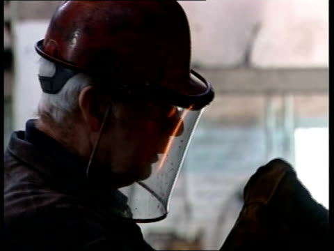 pickering report proposes reforms; itn scotland: int bv steel worker shaping white hot steel in foundry england: london: cms alan pickering sitting... - part time worker stock videos & royalty-free footage