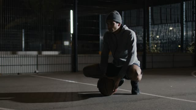 pensive athlete with basketball on court at night - daydreaming stock videos & royalty-free footage