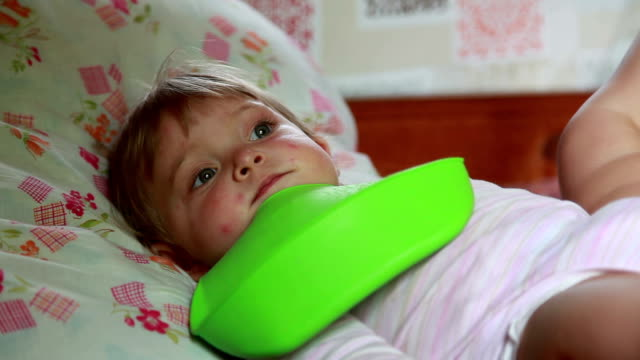 pensive baby lying on the bed - lying on back stock videos & royalty-free footage