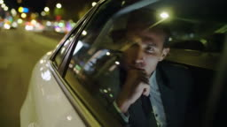 MS Pensive businessman on the back seat of a car
