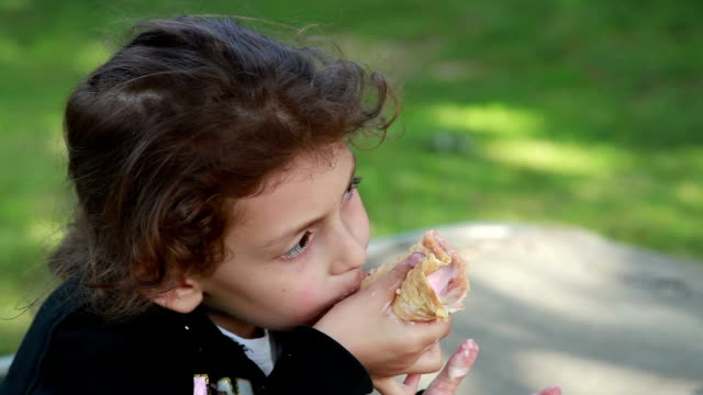 pensive little girl eating ice-cream - messy stock videos & royalty-free footage