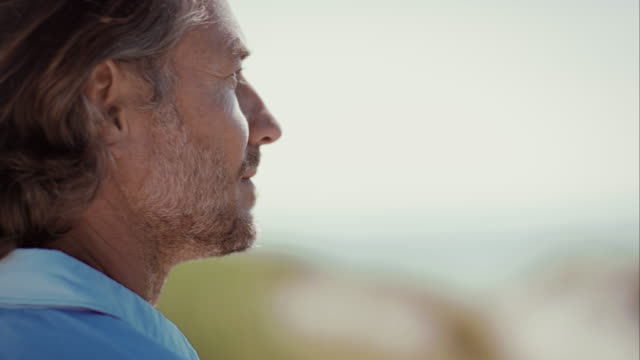 Pensive man at beach looking into distance