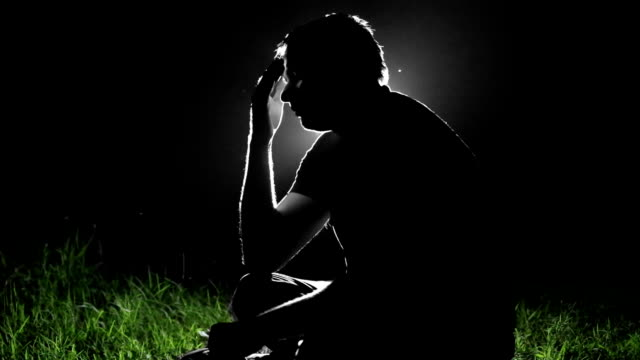 pensive man silhouette at night - despair stock videos and b-roll footage