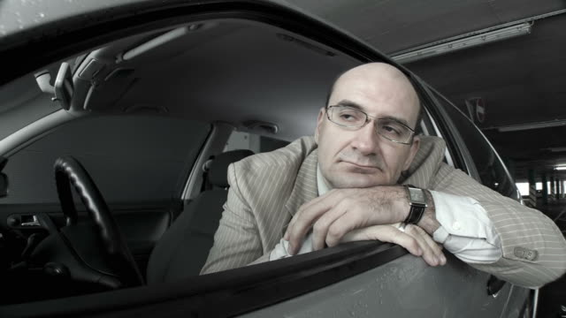 hd dolly: pensive mid adult man in a car - looking away stock videos & royalty-free footage