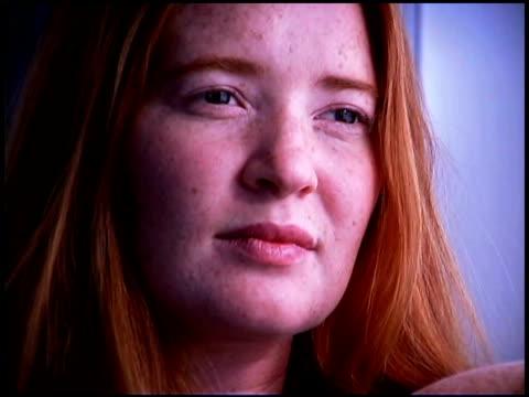 pensive redhead woman - endast unga kvinnor bildbanksvideor och videomaterial från bakom kulisserna