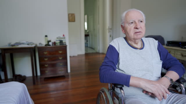 pensive senior man in wheelchair - wheelchair stock videos & royalty-free footage