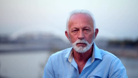 pensive senior man looking at camera - beard stock videos & royalty-free footage