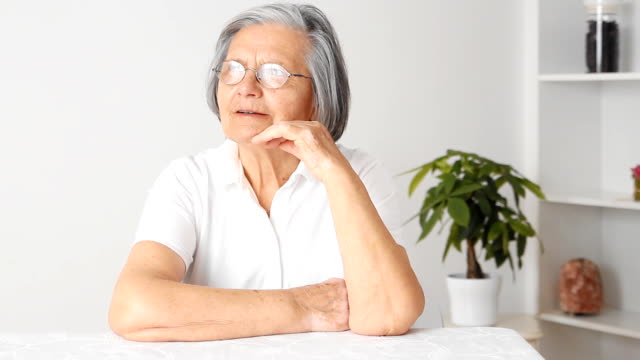 pensive senior woman - hand on chin stock videos & royalty-free footage
