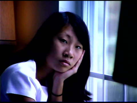 pensive teenage girl by window - one teenage girl only stock videos & royalty-free footage