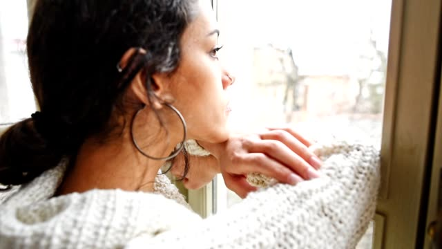 pensive woman in front of the window - introspection stock videos & royalty-free footage