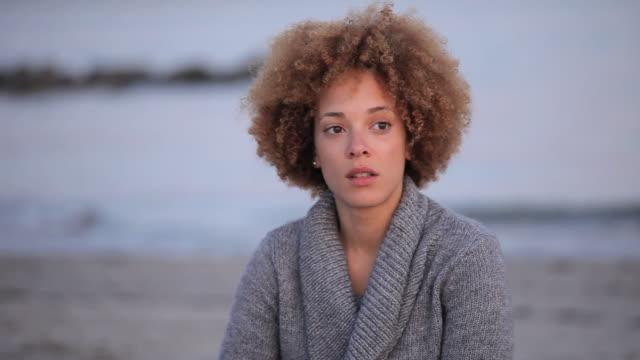 MS PAN Pensive woman sitting on Virginia Beach / Virginia, USA