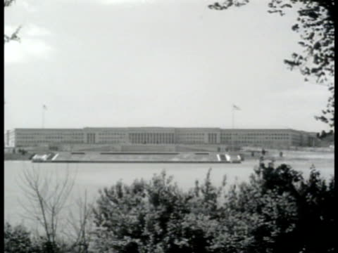 pentagon building w/ potomac river fg. ext pentagon w/ cars parked fg. meeting w/ general somervell sitting at head of table w/ staff of seven major... - 1943 stock-videos und b-roll-filmmaterial