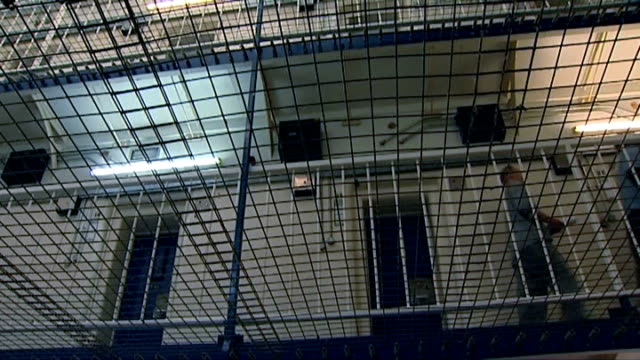 pentonville prison judged to have serious failings; file / date unknown int low angle shots of upper landings and netting ext security camera seen... - wire mesh fence stock videos & royalty-free footage