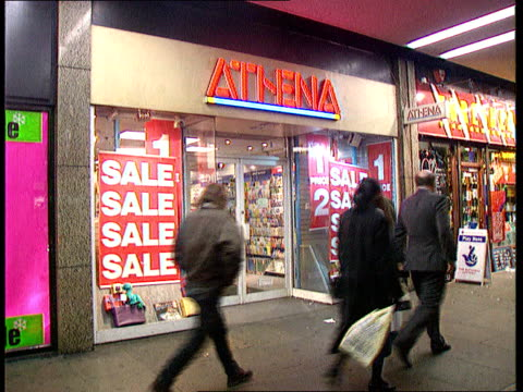 Dillons and Ryman under threat INT London Athena MS Athena shop with 'Sale' notices in window LA MS Ditto as shoppers past MS Ditto C10119401