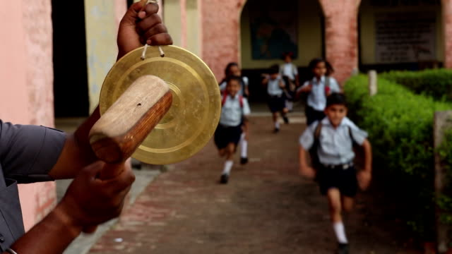 peon ringing bell in school, haryana, india - school bell stock videos and b-roll footage