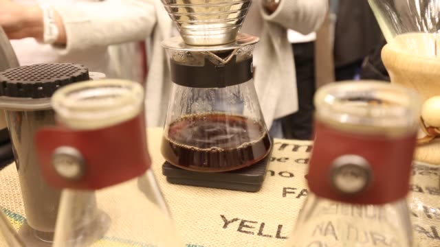 Peopel take part in a cupping a coffee tasting at the Warsaw Coffee Festival in Warsaw Poland on February 9 2019