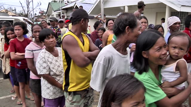 people across the philippines are struggling to rebuild their lives in the wake of typhoon haiyan. sky news' chief correspondent, stuart ramsay, has... - rebuilding stock videos & royalty-free footage