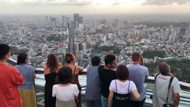 people admire the city skyline from the roppongi hills mori tower on august 14 2019 in tokyo japan - roppongi hills stock videos and b-roll footage