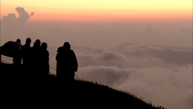 people admiring the sea of clouds from gassan shrine - yamagata prefecture stock videos & royalty-free footage