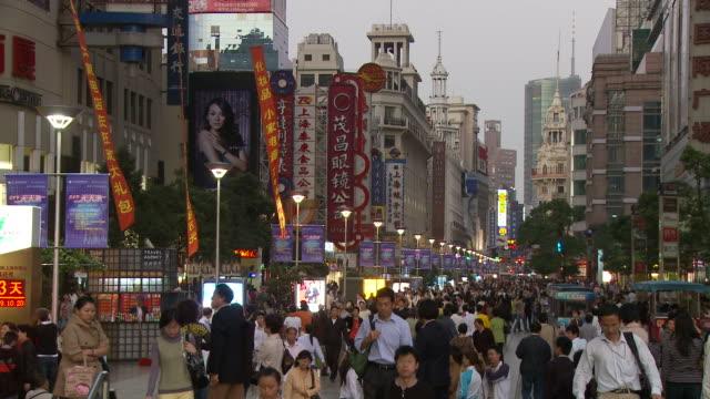 people along nanjing road in shanghai china - nanjing road stock videos & royalty-free footage