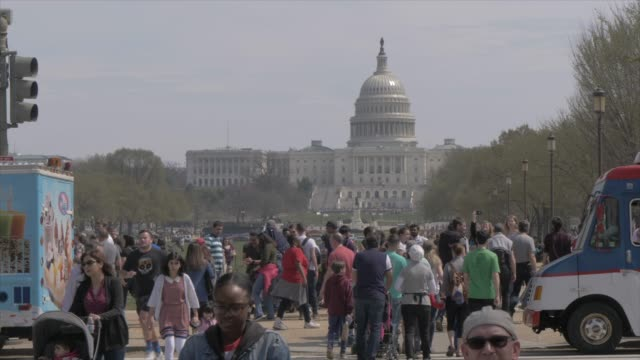 people and activities on national mall, us capitol in background, washington dc, united states of america, north america - capitol building washington dc stock videos & royalty-free footage