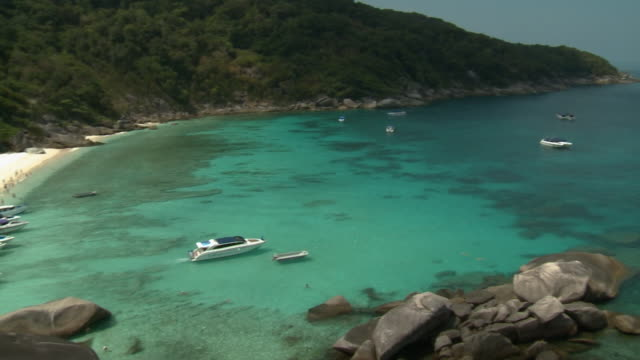 people and boats in bay and andaman sea - andaman sea stock videos & royalty-free footage