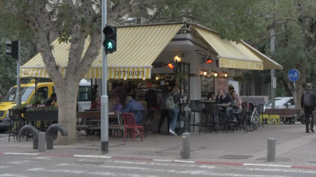 people and cafe on rothschild boulevard, tel aviv, israel, middle east - israel stock videos & royalty-free footage