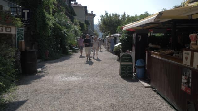 People and cafes on Isola dei Pescatori, Lake Maggiore, Piedmont, Italian Lakes, Italy, Europe