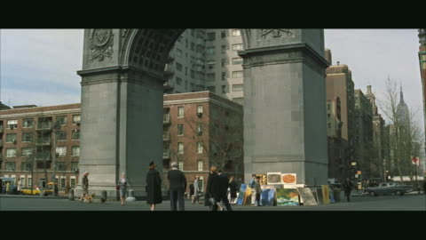 ws pan people and cars in washington square park  / new york city, new york, usa - greenwich village stock videos & royalty-free footage