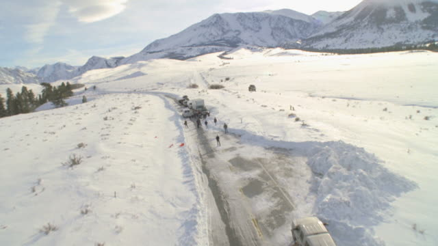 ws pov people and cars on snow covered road  / mammoth lakes, california, usa - mammoth lakes video stock e b–roll
