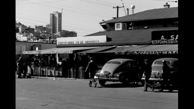 people and cars passing by fisherman's wharf restaurants and shops fisherman's wharf restaurants and shops on january 01 1940 in san francisco... - north beach san francisco stock videos & royalty-free footage