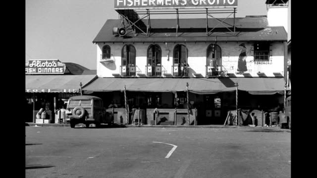 stockvideo's en b-roll-footage met people and cars passing by fisherman's wharf restaurants and shops fisherman's wharf restaurants and shops on january 01 1940 in san francisco... - fisherman's wharf san francisco