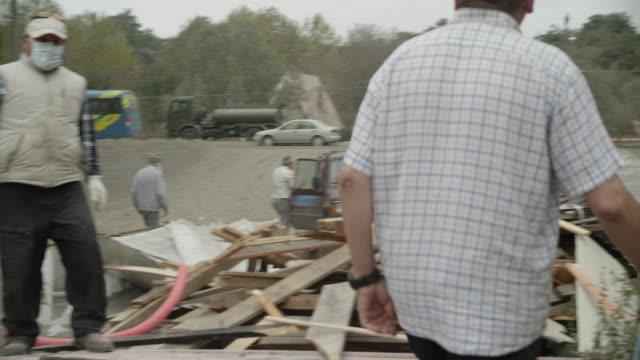 ensenada, chile - april 26, 2015: people and destroyed building - 自然災害点の映像素材/bロール