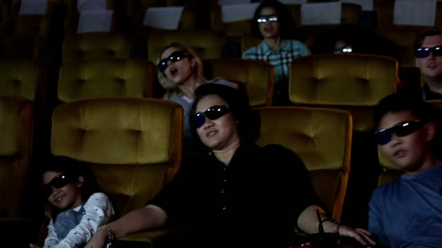people and family sit watching 3d movie in cinema together with happiness - 3d glasses stock videos & royalty-free footage