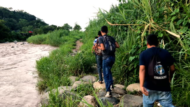 people and goods cross the suchiate river from guatemala into mexico on august 9 2018 in talisman mexico the illegal crossing point is located just... - guatemala stock videos & royalty-free footage