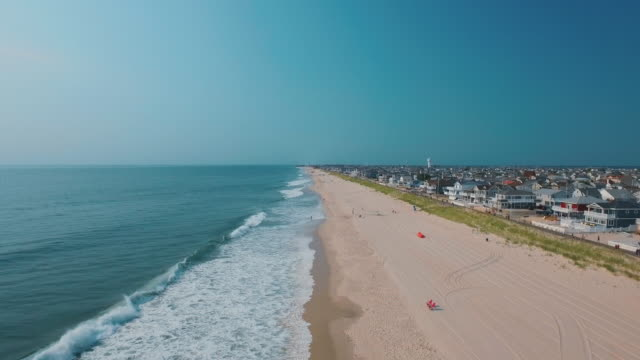 People and houses at ocean beach, Spring Lake, New Jersey, United States