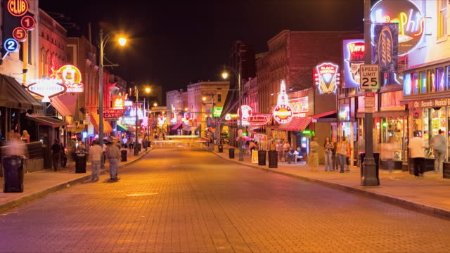t/l ws people and illuminated neon signs in beale street at night, memphis, tennessee, usa - memphis tennessee stock-videos und b-roll-filmmaterial