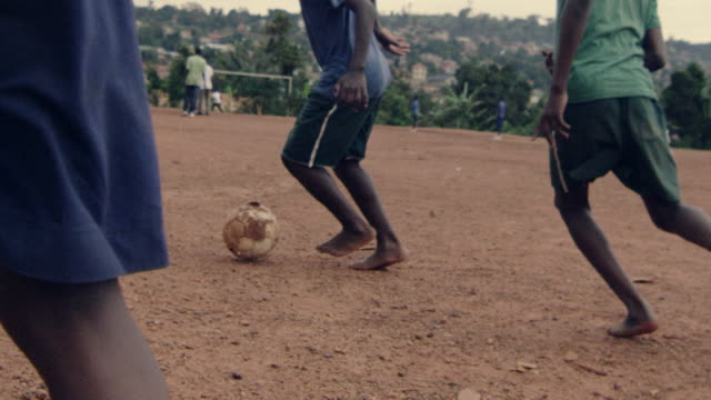 people and places of kampala, uganda - barefoot点の映像素材/bロール