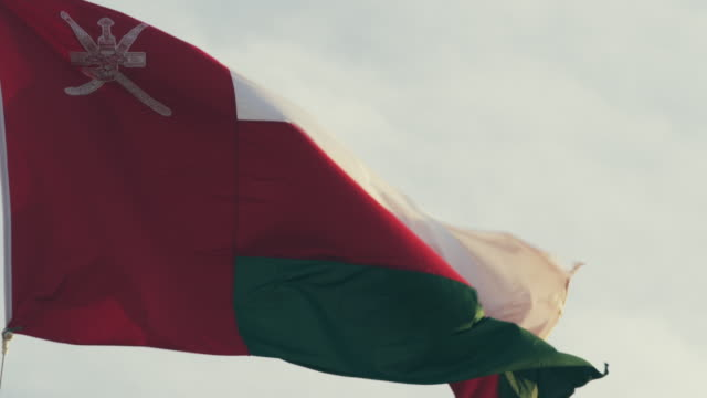 people and places of muscat and salalah, oman - oman flag stock videos and b-roll footage