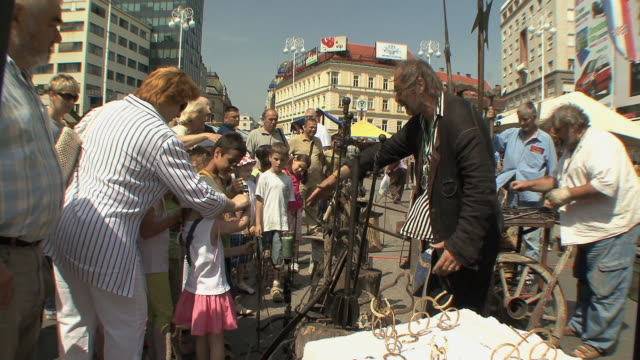 ws people and stalls during summer fair in zagreb's main square / zagreb, croatia - zagreb stock videos & royalty-free footage