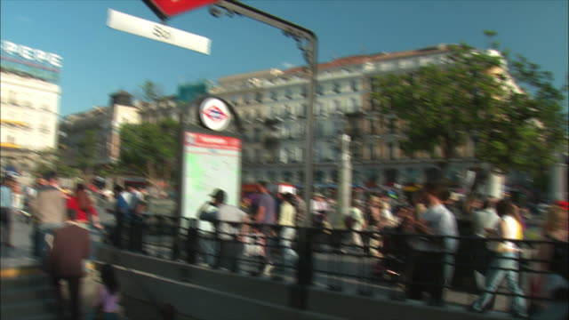 WS PAN TU People and subway station sign in Puerta Del Sol, Madrid, Spain