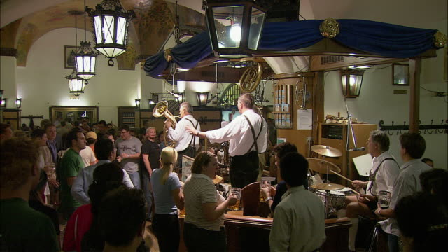WS HA People and traditional Bavarian band enjoying beer in Hofbrauhaus, Munich, Bavaria, Germany