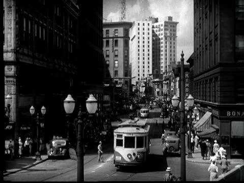 """1937 FILM MONTAGE HA WS People and traffic at busy intersection/ Atlanta, Georgia """