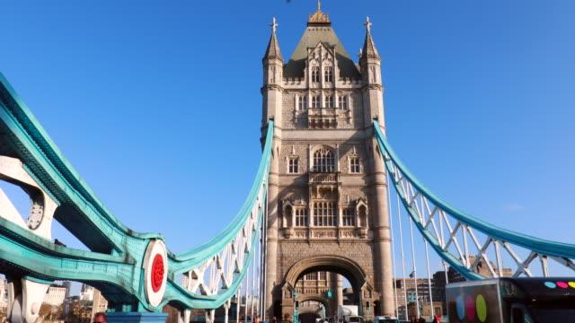 people and traffic crossing tower bridge, pan up - tower bridge stock videos & royalty-free footage