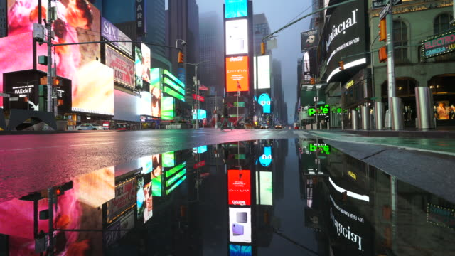 people and traffic disappeared from times square for impact of covid19 in the rainy night to early morning on mar 29 2020 - times square manhattan stock videos & royalty-free footage