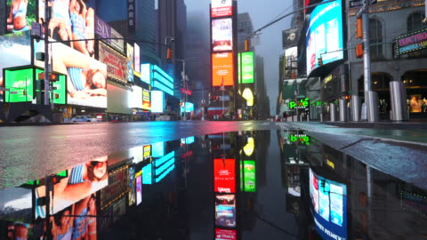 people and traffic disappeared from times square for impact of covid-19 in the rainy night to early morning on mar. 29 2020. - digitally generated image stock videos & royalty-free footage