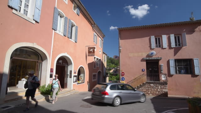 people and traffic in old town in ochre village roussillon - luberon stock videos & royalty-free footage